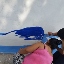 """4th grader Yurem and his mother paint his drawing, """"Protect our wetlands"""""""